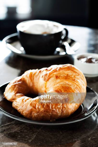 fresh croissantcup of coffee and croissants, - sweet bun stock pictures, royalty-free photos & images
