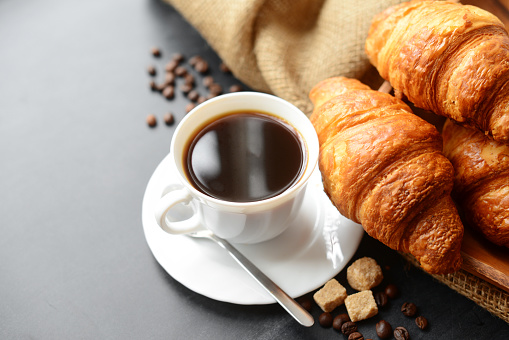 Fresh croissants and coffee 815629706