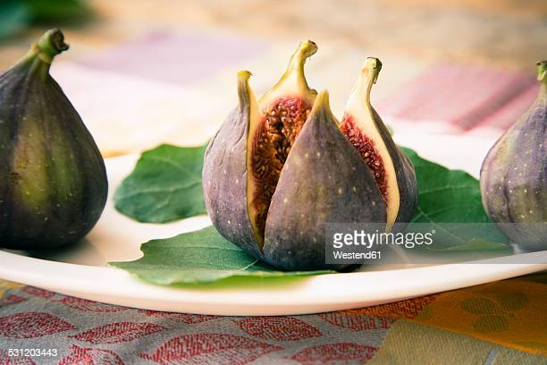 Fresh cut fig with leaves
