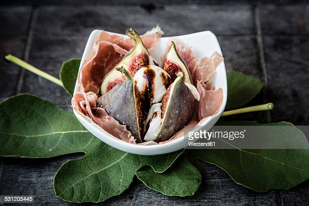 Fresh cut fig withmozzarella, Parma ham and leaves