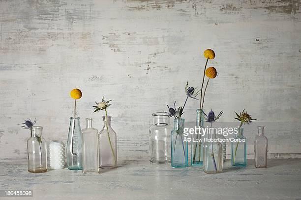 Fresh cut flowers in small vintage bottles
