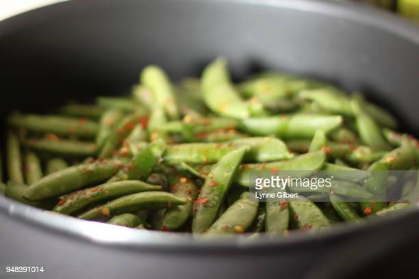 fresh cut green books with spices cook in a saucepan on a stove during the holidays - accompagnement photos et images de collection