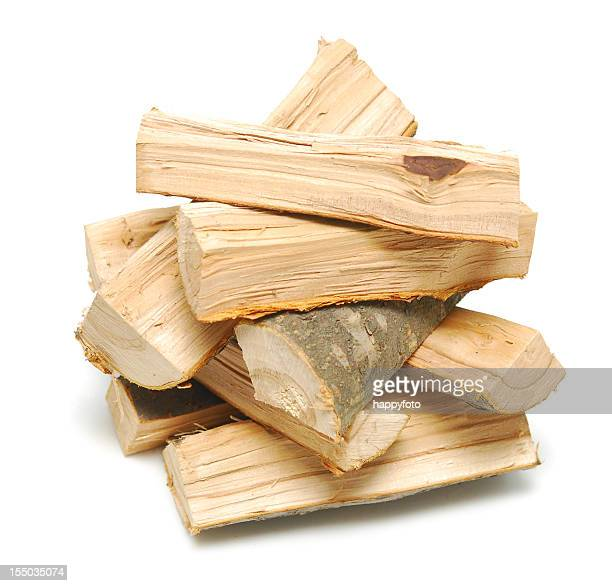 A fresh cut pile of wooden logs neatly stacked