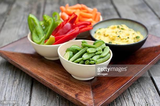 Fresh cut vegetables with hummus dip