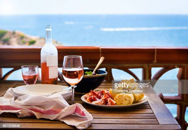 fresh delicious dinner - salad, bread, ham, rose wine on balcony - french food stock pictures, royalty-free photos & images