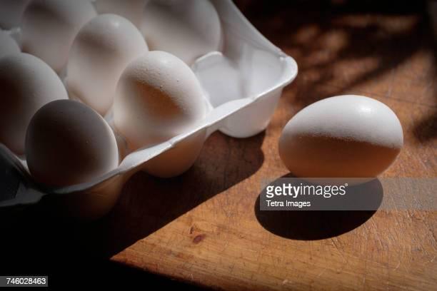Fresh eggs in carton on table