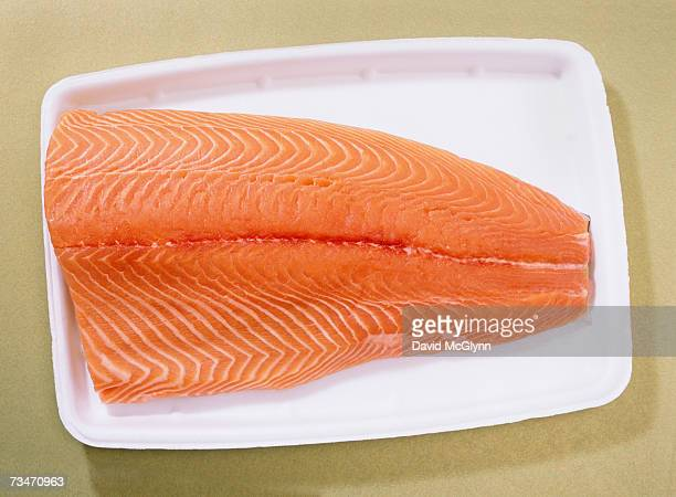 Fresh farmed atlantic salmon on styrofoam supermarket tray