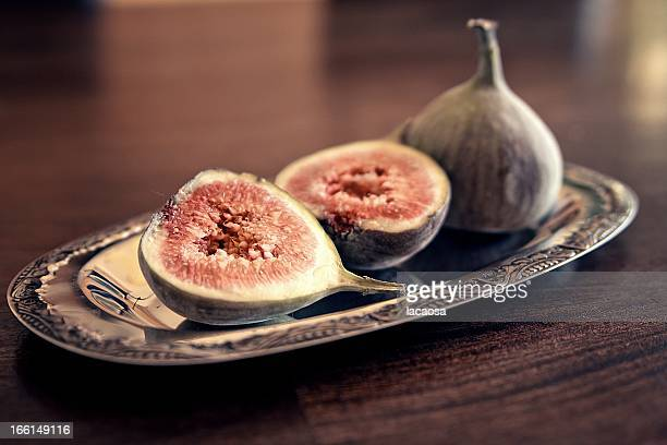 Fresh figs on a silver tablet