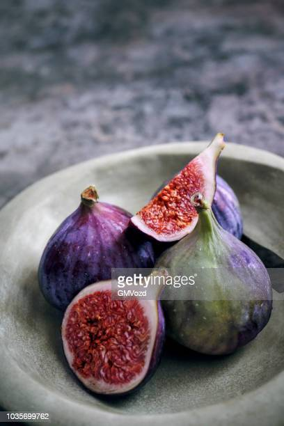fresh figs on rustic background - fig stock pictures, royalty-free photos & images