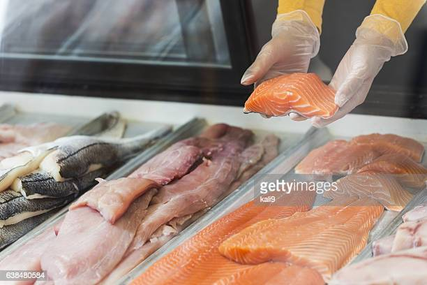 fresh fish fillets for sale in seafood store - fresh seafood stock photos and pictures