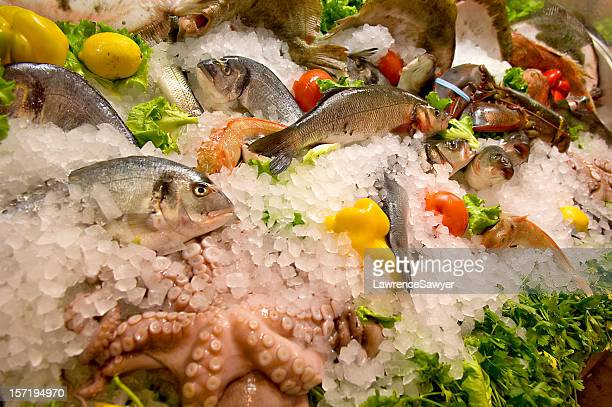 Fresh fish on packed ice with produce
