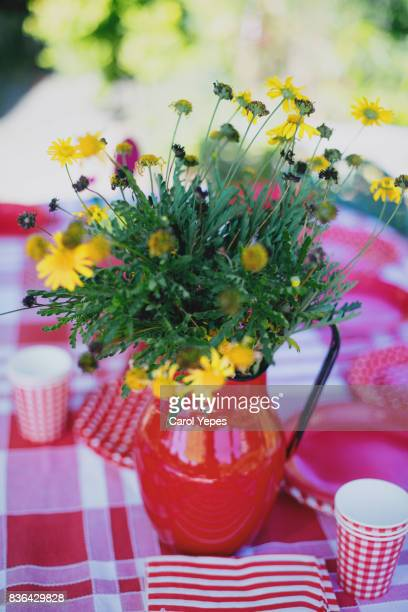 fresh flowers in  red vase