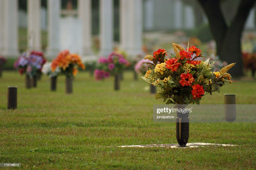 Fresh Flowers In Vases At A Cemetery Stock Photo Getty Images