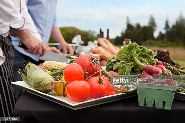 fresh food being prepared outdoors - harvest table stock pictures, royalty-free photos & images