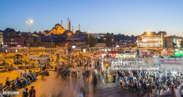 fresh food restaurant at galata bridge, in the backgrond the solyman mosque - istanbul province stock photos and pictures