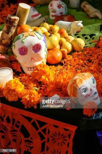 fresh fruit and flowers for day of the dead - day of the dead festival stock photos and pictures
