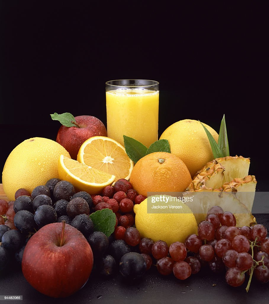 Fresh fruit and juice still life : Stock Photo