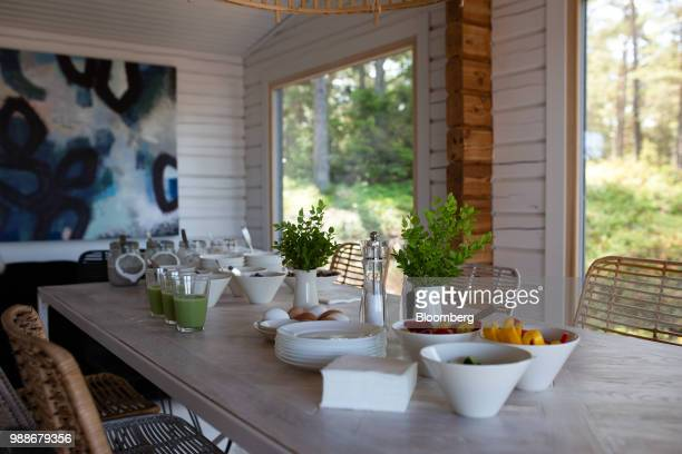 Fresh fruit and juices sit on a table in the dining area of a guest cabin on SuperShe island near Raasepori, Finland, on Wednesday, June 27, 2018....