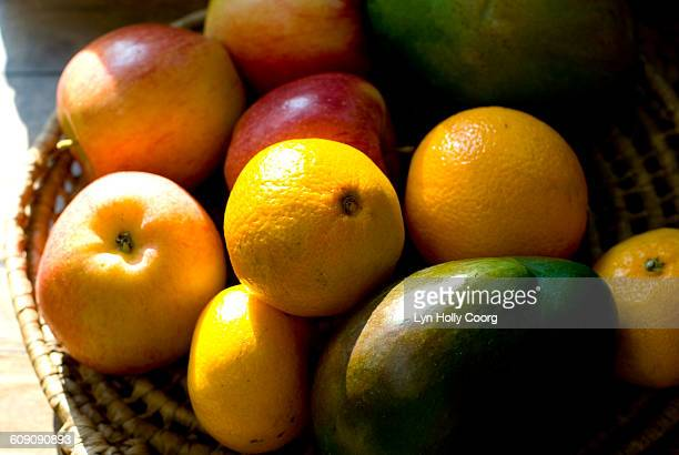 fresh fruit in basket - lyn holly coorg stock pictures, royalty-free photos & images