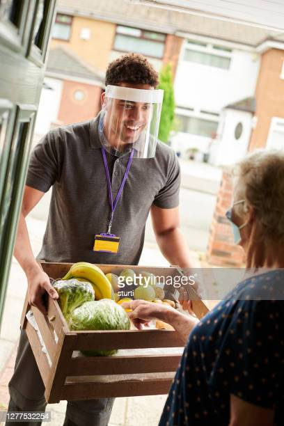 fresh fruit in lockdown - volunteer stock pictures, royalty-free photos & images