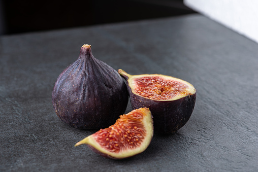 Fresh fruit isolated figs on the grey dark background - gettyimageskorea