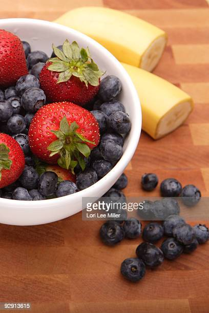 fresh fruit on cutting board - lori lee stock pictures, royalty-free photos & images