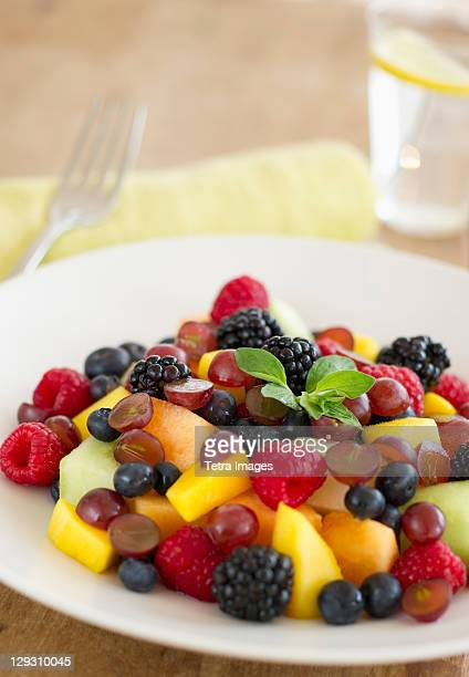 Fresh fruit salad in bowl on table