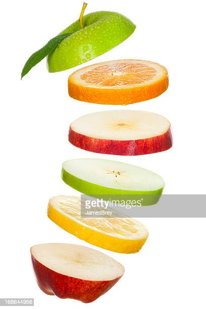 Fresh Fruit Slices; Apples, Lemon, Orange Tossed in Air