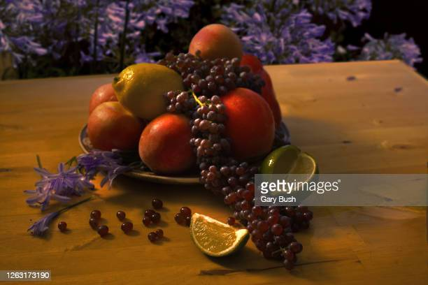 fresh fruit still life on table in outdoor setting - calabasas stock pictures, royalty-free photos & images