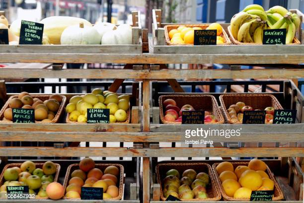 fresh fruits on market stall - market stall stock pictures, royalty-free photos & images