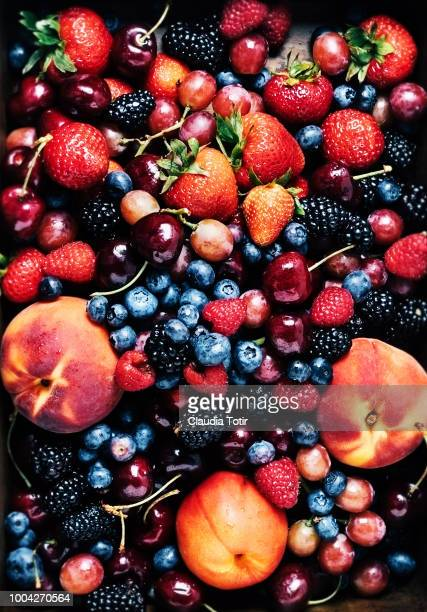fresh fruits (carry, berries, peaches) - berry fruit stock pictures, royalty-free photos & images