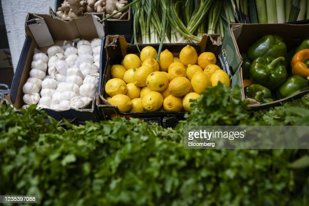 Fresh garlic, lemons and peppers for sale outside a supermarket on Sonnenallee in Berlin, Germany, on Monday, Sept. 13, 2021. Refugees from Syria...