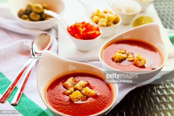 Fresh Gazpacho soup in a white bowls served for two