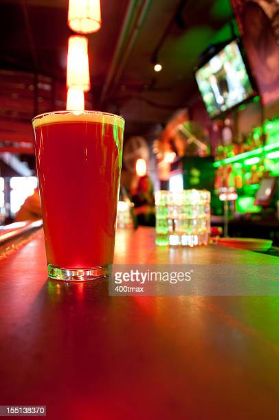 Fresh glass of beer on a bar