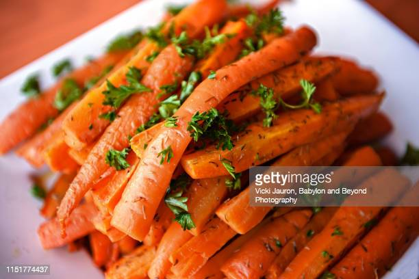 fresh glazed carrots with parsley for turkey dinner - glazed food stock pictures, royalty-free photos & images