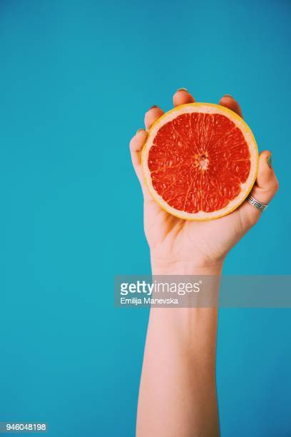 fresh grapefruit - squeezing stock pictures, royalty-free photos & images