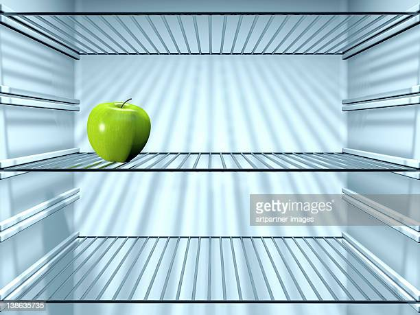 Fresh Green Apple in an empty fridge