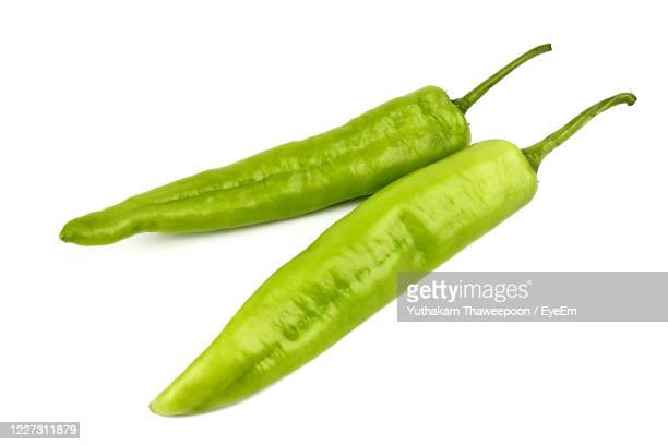 fresh green banana peppers or sweet peppers isolated on a white background - green chili pepper stock pictures, royalty-free photos & images