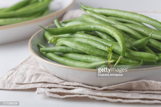 fresh green beans on a plate - green bean stock pictures, royalty-free photos & images