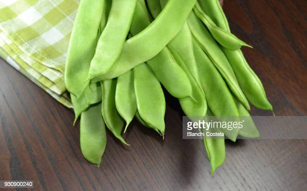 Fresh green beans on wooden background