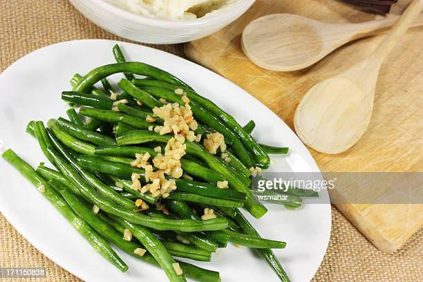 Fresh green beans serves with crushed nuts