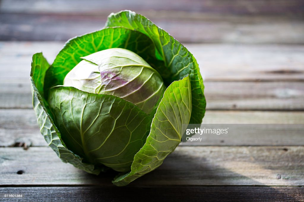Fresh green garden cabbage on rustic wooden background : Stock Photo