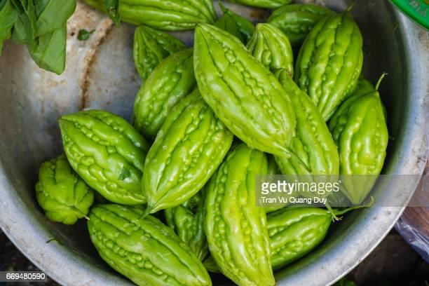 Fresh green mini bitter gourd (goya) or bitter melon