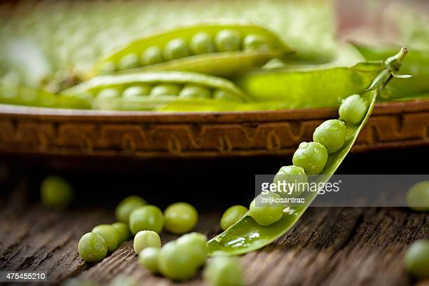 Fresh green pea on the wooden table