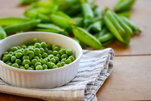 fresh green peas - peas stock pictures, royalty-free photos & images