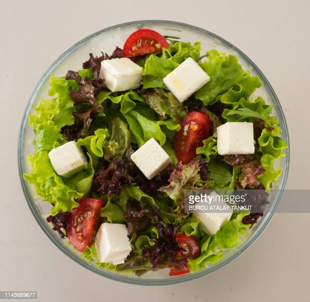 fresh green salad with feta cheese - green salad stock pictures, royalty-free photos & images