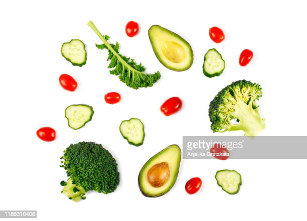 fresh green vegetables isolated on white background. flat lay. food concept - kale stock pictures, royalty-free photos & images