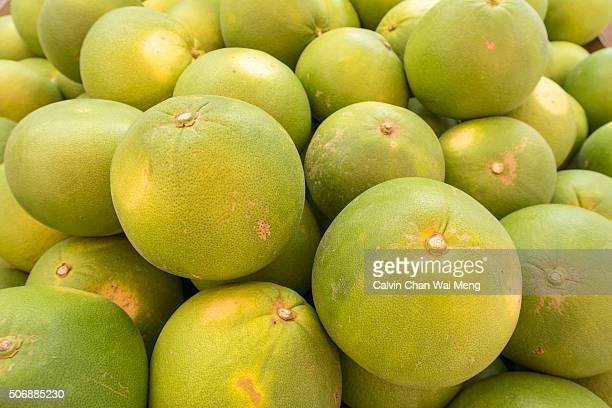 Fresh green whole pummelo grapefruit  for sale in market stall