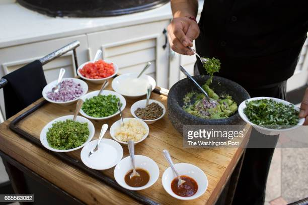 SCOTTSDALE AZ MARCH 18 2017 Fresh guacamole is prepared tableside at The Mission on March 18 2017 in Scottsdale Az