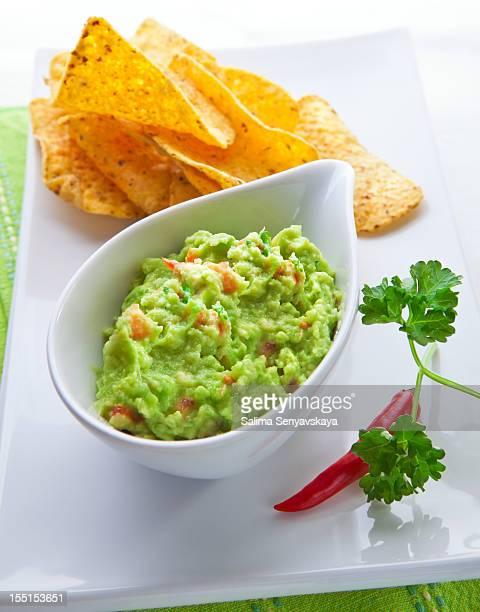fresh guacamole - guacamole stock photos and pictures
